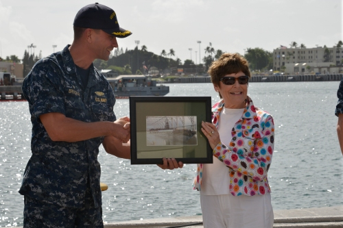 PEARL HARBOR (NOV. 9, 2015) Cmdr. Wes Bringham presents a photograph of the USS Bremerton as a gift to the mayor of Bremerton, Wash., Patty Lent. Bringham told Mayor Lent he appreciates all the support his crew receives from the city of Bremerton and the Navy League chapter located there. (U.S. Navy photo by Lieutenant Brett Zimmerman/Released)
