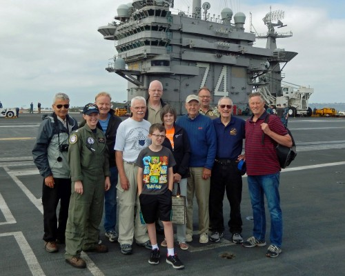 "Bremerton NL Tigers: Left to right: Joe Baney, Lt. Michelle Mayer, USN, (our host and tour coordinator), Kevin Nortness. Bernard Korth, Gary Simpson, Jo Nelson, Fred Nelson, Anthony ""AJ"" Bredberg, Robert Satterthwaite, George Cargill, and in front, Anthony Dinsmore."