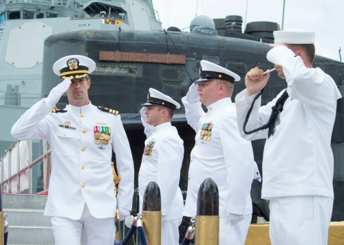 160805-N-LY160-334 JOINT BASE PEARL HARBOR-HICKAM, Hawaii (August 5, 2016) Cmdr. Travis W. Zettel, commanding officer of the Los Angeles-class fast-attack submarine USS Bremerton (SSN 698), salutes sideboys during a change of command ceremony on Joint Base Pearl Harbor-Hickam. (U.S. Navy photo by Mass Communication Specialist 2nd Class Michael H. Lee)